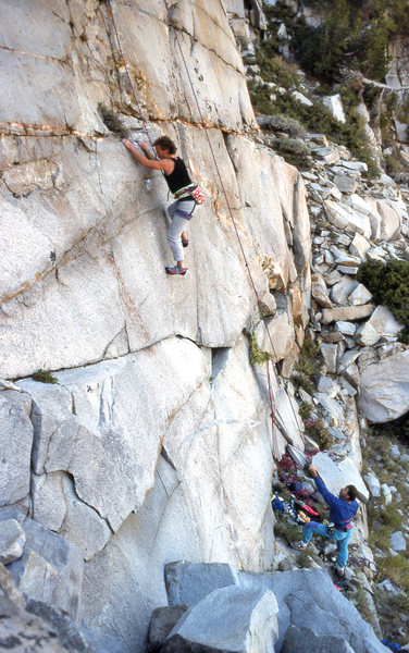 "Urmas higher up ""Girl on Fire"" (5.11d)."