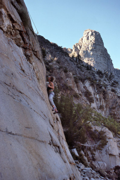 "Urmas on ""Girls On Fire"" (5.11d) with the Sphinx formation in the background."