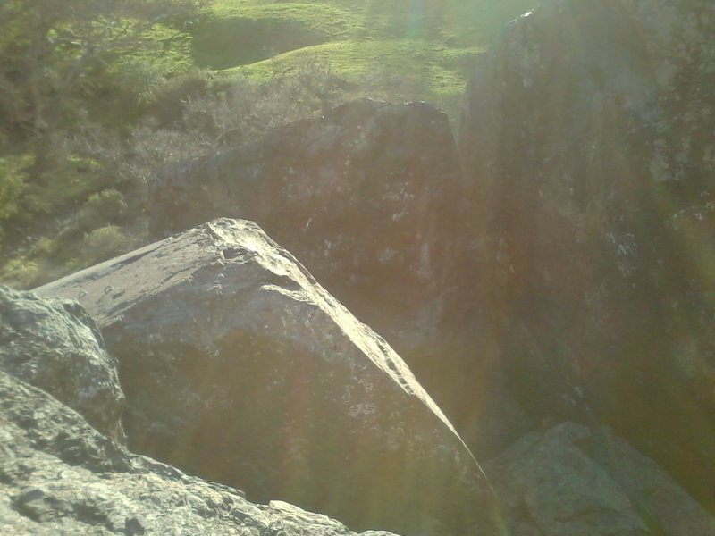 Bolts for Freeway 5.6, Face it 5.10c and Pull Up 5.10b as seen from the top of the Northeast Boulder