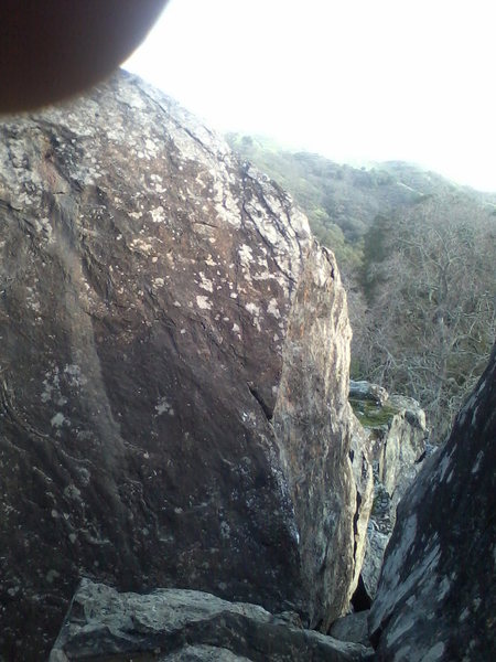Grin and Bear it 5.10b (Left)  On the Edge (Far Right) directly across from bat crack