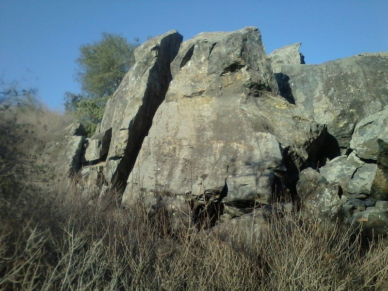 Another view of the three face climbs on the Northwest boulder (Left Side) viewed from the south.  The Cleavage is the obvious chimney in the middle and there is a 5.8 face climb just to the right of the Cleavage.  The Ramp 5.7 is further to the right.