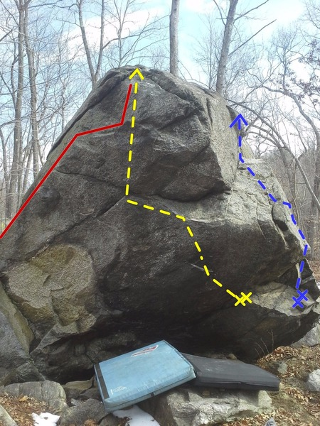 Overhanging side of boulder. Feel the Bern (v6) in yellow, v0-1 warmup in red, MAGA in blue.