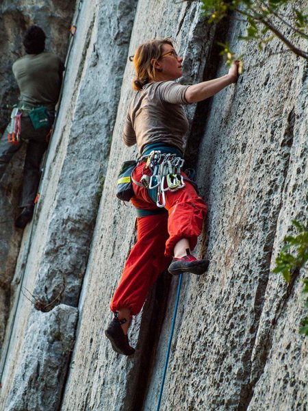 Micaela on the early moves of the climb. Red pants are courtesy of the Tuesday market.