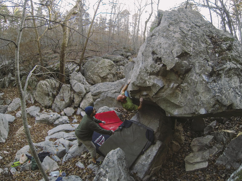 "Justin Frese on my FA ""Diamonds are Forever"" **** v7/8 @ James Bond Boulder - Paddy Creek Wilderness. Golden Eye is the cave to the right."