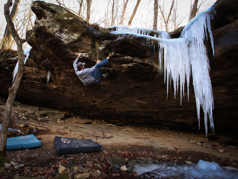 """""""The Nemesis"""" FA - v9 - This one starts at the golden utter about 35+ feet back in the cave and tops out on the head to my left. Classic."""
