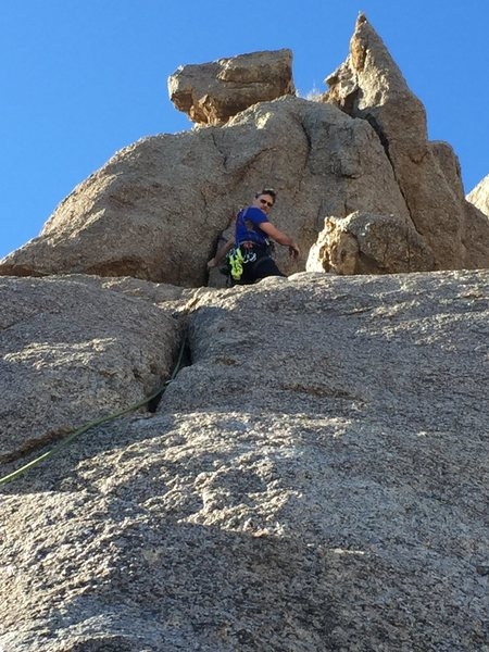 Standing at the base of the final crux portion of the climb--with rap anchors above and between the two highest features.