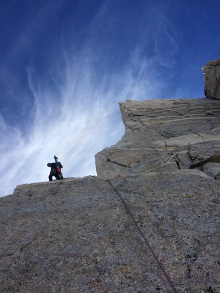 top of what I think is the 4th pitch in the topo. Right before crossing back over the arete. We found a shiny 2 bolt anchor with rap rings here