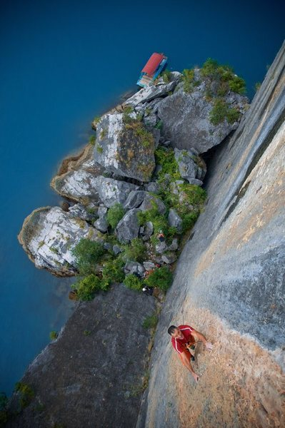 "One of the crew climbing ""The Face"" wall in Halong Bay"