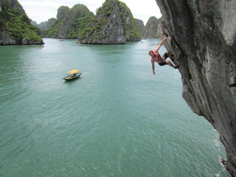One of the crew deep water soloing in Lan Ha Bay.