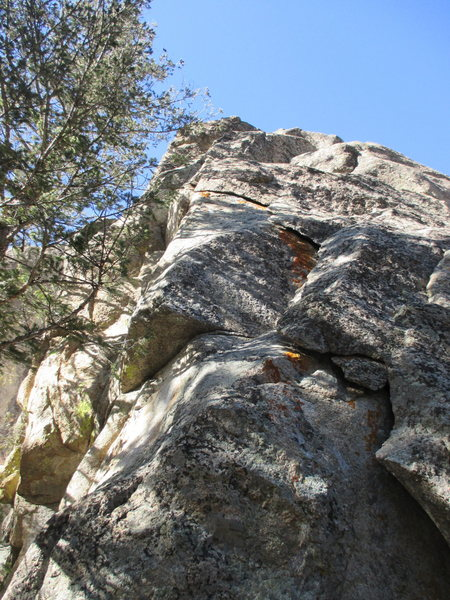 Flaked Out ascends the jagged flake system on the East-facing wall of the Cenotaph Crag.