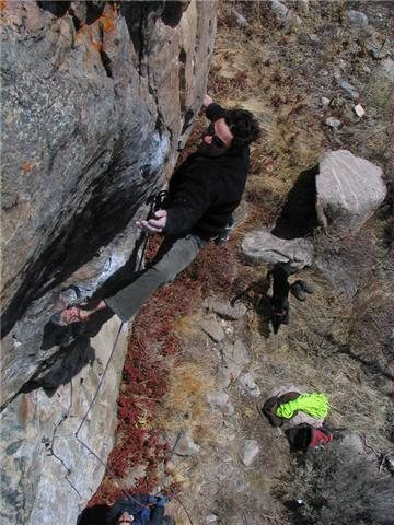 The route's crux sequence with an appearance from Frank in the background.