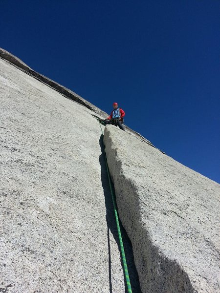 This is the 5.5 section on the 1st Pitch if you are going to the 60 meter rope belay station.  If you have a short rope, it would be the start of the second pitch.  The photo shows the crack at 37.739681, -119.539680