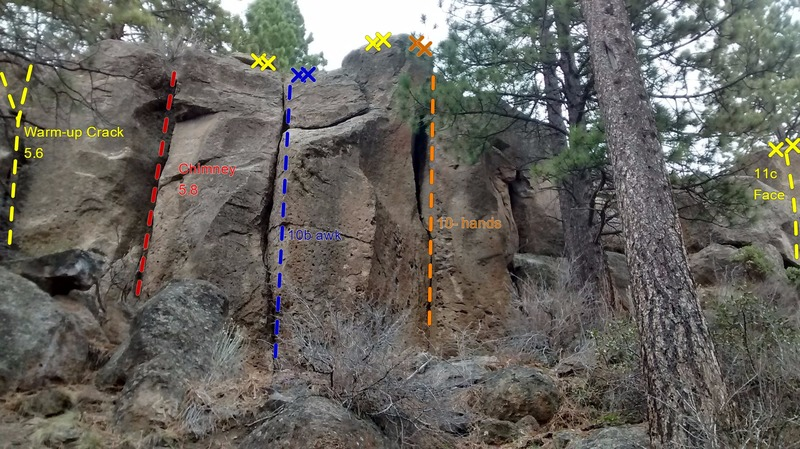 Warm-up Crack is barely visible on the far left. A 5.11 face route is barely visible on the right.