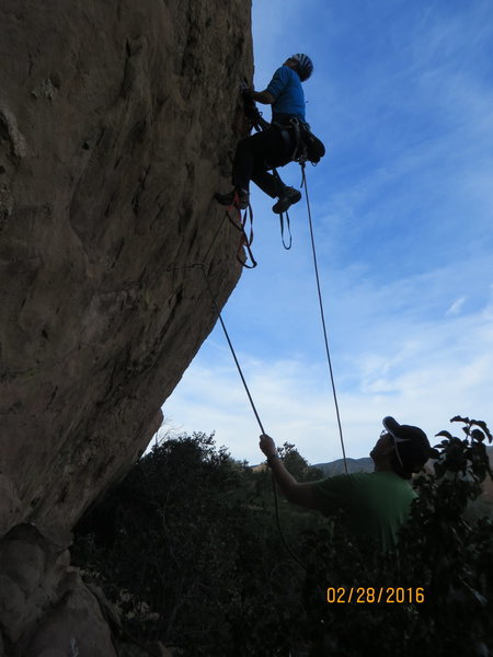 "Aiding up the overhung lower portion of the Pangea Wall on ""Tex-Mex."""