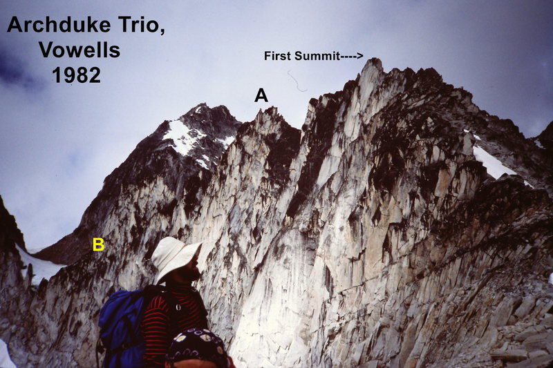 """[photo@POUND@2] Helmut Microys surveys the Archduke Trio from cirque - the climb starts on the right. """"A"""" and """"B"""" are the same features as in photo@POUND@1."""