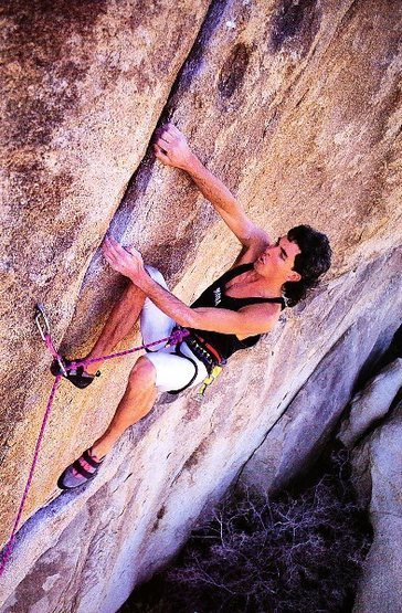Scott Cosgrove on Rastafarian (5.13b), Joshua Tree NP<br> <br> Photo by Greg Epperson