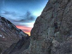Rock Climbing Photo: Jordan Traxioning up Double Standard at sunset.