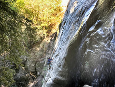 Rock Climbing Photo: Climber top-roping the falls.
