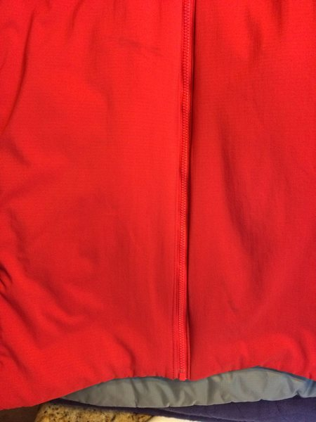 Two marks on mid-low portion of jacket.