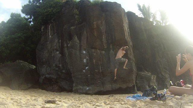 Mario Morante traversing across a damp Finger Machine Traverse in Waimea Bay during his honeymoon vacation.