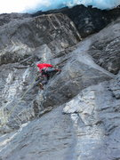 Rock Climbing Photo: The crux of the third pitch.  Pulling the roof is ...