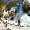 "MG is right above the climber's head.  Don M. says ""lots of options"" here; on this late season, fat-ice-everywhere day in 2008 we climbed the ice-filled cleft on the left for a long pitch that met MG at the top."