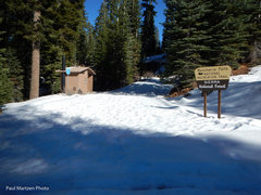 Rancheria Falls trailhead and outhouse.  In the summer, you can drive this far and hike less than a mile to the falls.  In the winter you have to ski a mile and a quarter up a road to this point, then ski on the trail another 8/10 of a mile.  You could also snowshoe.  The road is also a snowmobile route.
