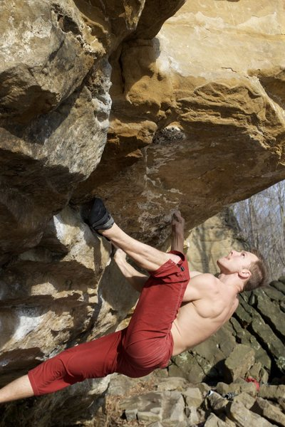 Cory bouldering just left of Doug's Roof. V7<br> 3-8-16