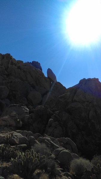Approach from backside. Go through notch right of angular perched boulder.
