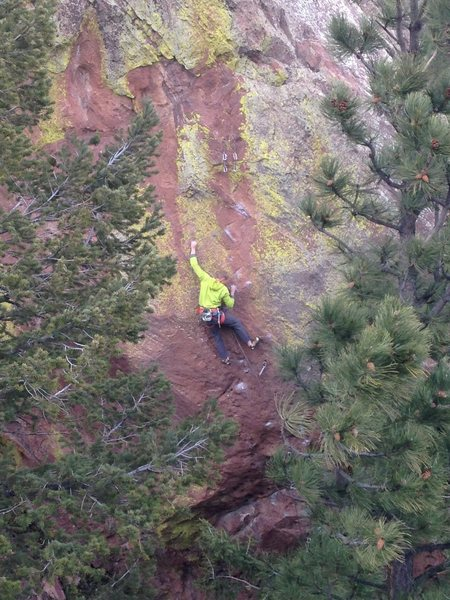 Chad Volk climbing through the beautiful colors of Power Bulge just before the anchors.