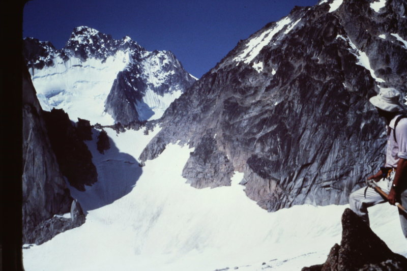 From Summit of Eastpost: Howser Towers framed by the Snowpatch-Bugaboo Col (More snow in 1982)