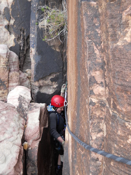 In the tight squeeze chimney at the top of pitch 3