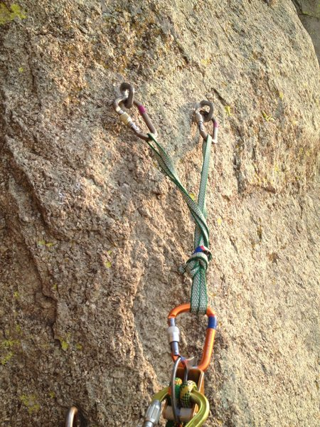This is what you can expect for most of the belay ledges on Durance. Two or three bolts at about chest height, very solid.