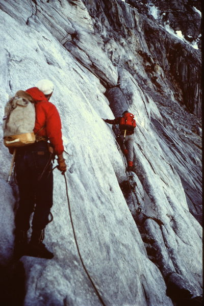 """Belaying"" on the ledges of the ""South / South West"" face below the Hourglass during a 1967 ascent of Mt Sir Sandford."
