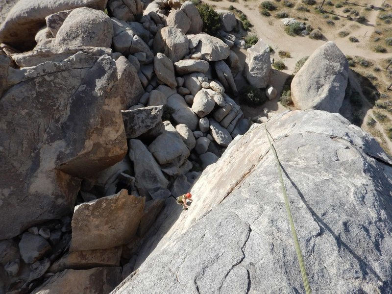 Brenda starts up the SW Corner climb on the Headstone at Joshua Tree, March 2016