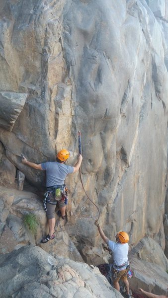 First clip of Suzie's is not so much climbing as a scramble. Please note the photographer is standing where some people setup their belay station (in other photos on Mtn Proj) which gives a better view of your climber but risks the belayer taking a dive forward during a fall.