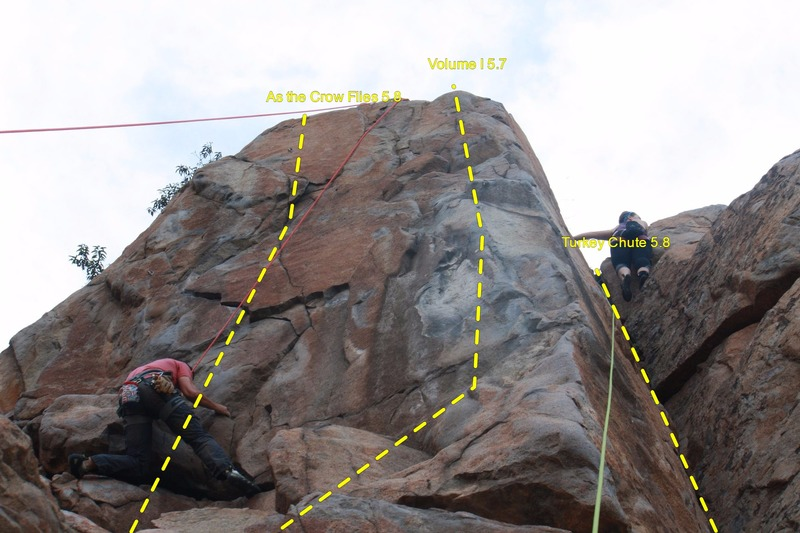 Decent shot of As the Crow Flies 5.8 (red rope climber), the arete between them is Volume I 5.7, and the dihedral is Turkey Chute 5.8 (green rope climber).