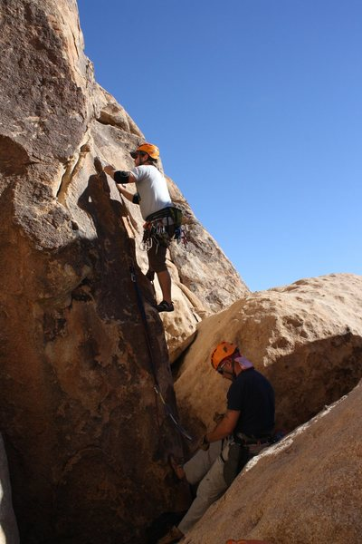Belay station for Gandy (5.9) is kind of over this small chasm so we had our belayer anchor into the first bolt.