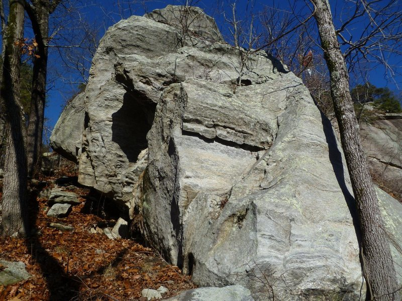 Two boulders uphill from the approach trail boulder. Mostly easier climbs here. Be careful as there are a lot of brittle thin flakes that could break off. <br> <br> You can see the top of this boulder when looking down from the main face