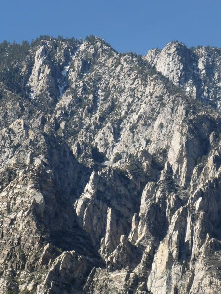 Coffman's Crag at the upper left hand corner.  One of the tram towers blends in well with the granite near the middle of the picture, taken from Chino Ridge.