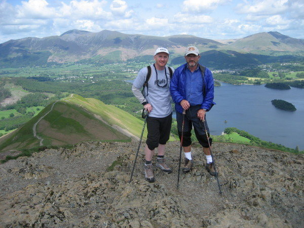 Two intrepid hikers on the summit of Catbells .