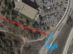 Found that if you follow it trail it takes you all the way to Tech Center Dr. A large dirt pullout can be used for parking instead of using any of the businesses. Take the trail all the way to the boulders. Watch for mtn bikers!