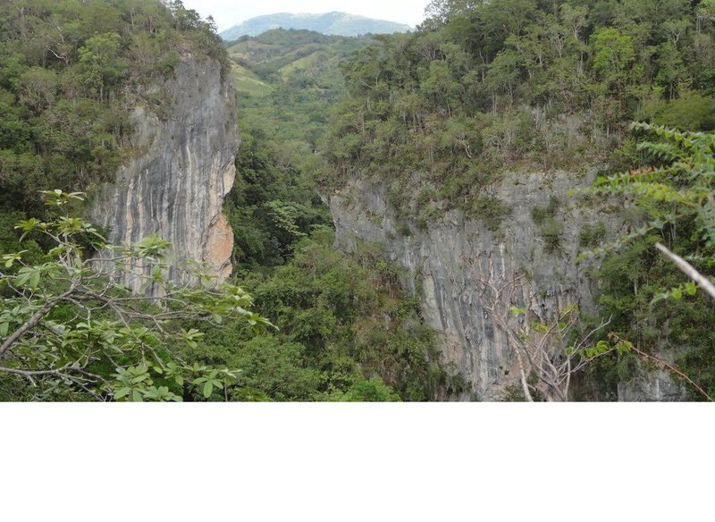 NW wall is on the left and SE wall is on the right. Cave crags are hidden in between these two