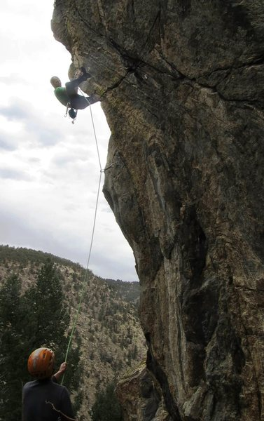 Setting up for the drive-by move below the crux.