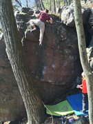 Rock Climbing Photo: Rolling the top of the boulder.