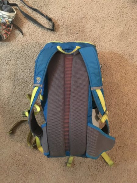 Mountain hardwear pack. I don't remember the name of it, but this a very stripped down, basic pack. Probably ~25-30L. One large interior pocket with cinch closure, one brain pocket, two hip belt pockets and two side pockets. There is a small tear in the bottom seam about ~2 inches long, could easily be sewn up. $40 obo