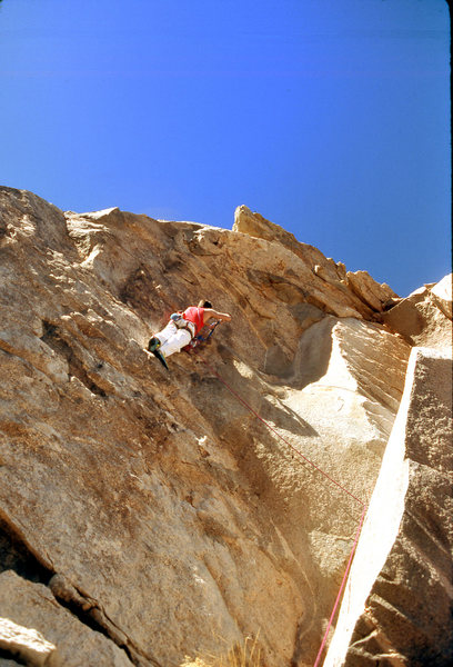 """Scott Cole drilling the 1st bolt on the ground up FA of """"The Bone Club"""" (5.10b) in December 1988"""