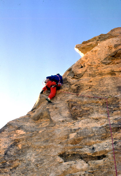 "Manteling up to the 2nd bolt placement on ""The Bone Club"" (5.10b), Lizard's Landing East Formation, December 1988"