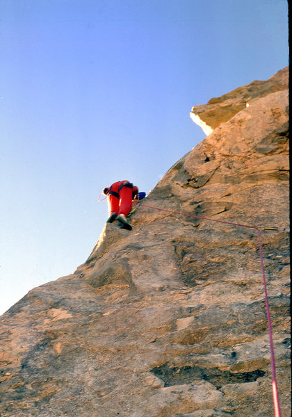 "Getting up to drill the 2nd bolt on the FA of ""The Bone Club"" (5.10b) in December 1988"
