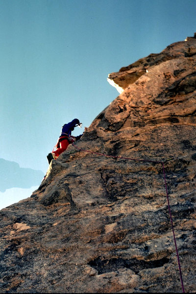 "Hand-drilling the 3rd bolt on the FA of ""The Bone Club"" (5.10b) in December 1988"